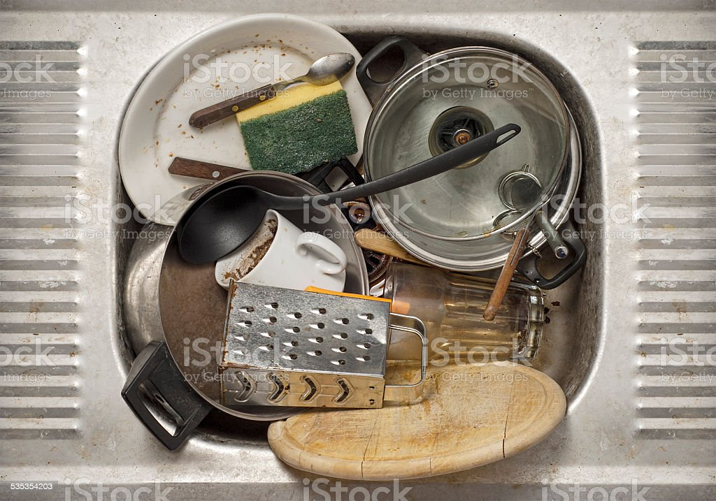 Dirty dishes in the sink stock photo