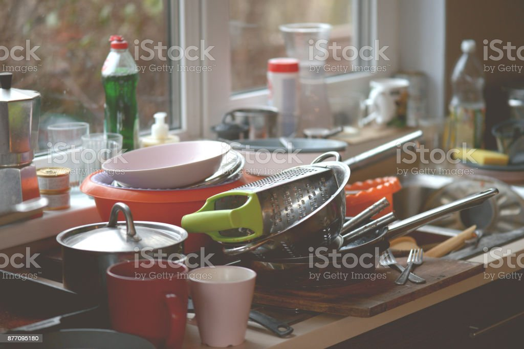 dirty dishes in the sink dirty dishes in the sink Bottle Stock Photo