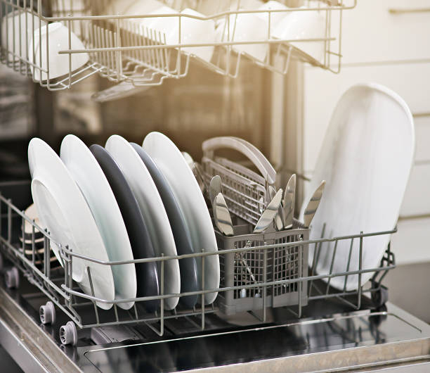 Dirty dishes no more Shot of a dishwasher at home dishwasher stock pictures, royalty-free photos & images