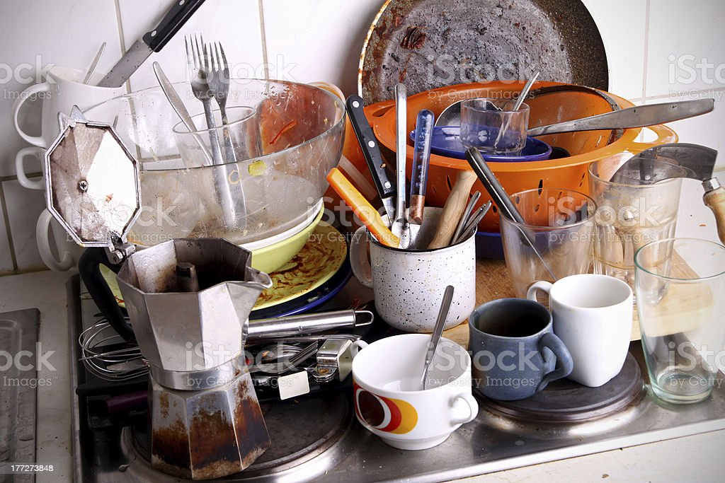 dirty dishes waiting for the flatmate stock photo