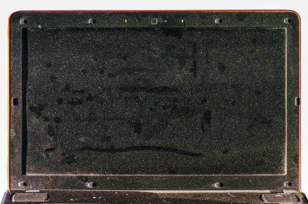 Dirty dusty laptop screen in the office stock photo