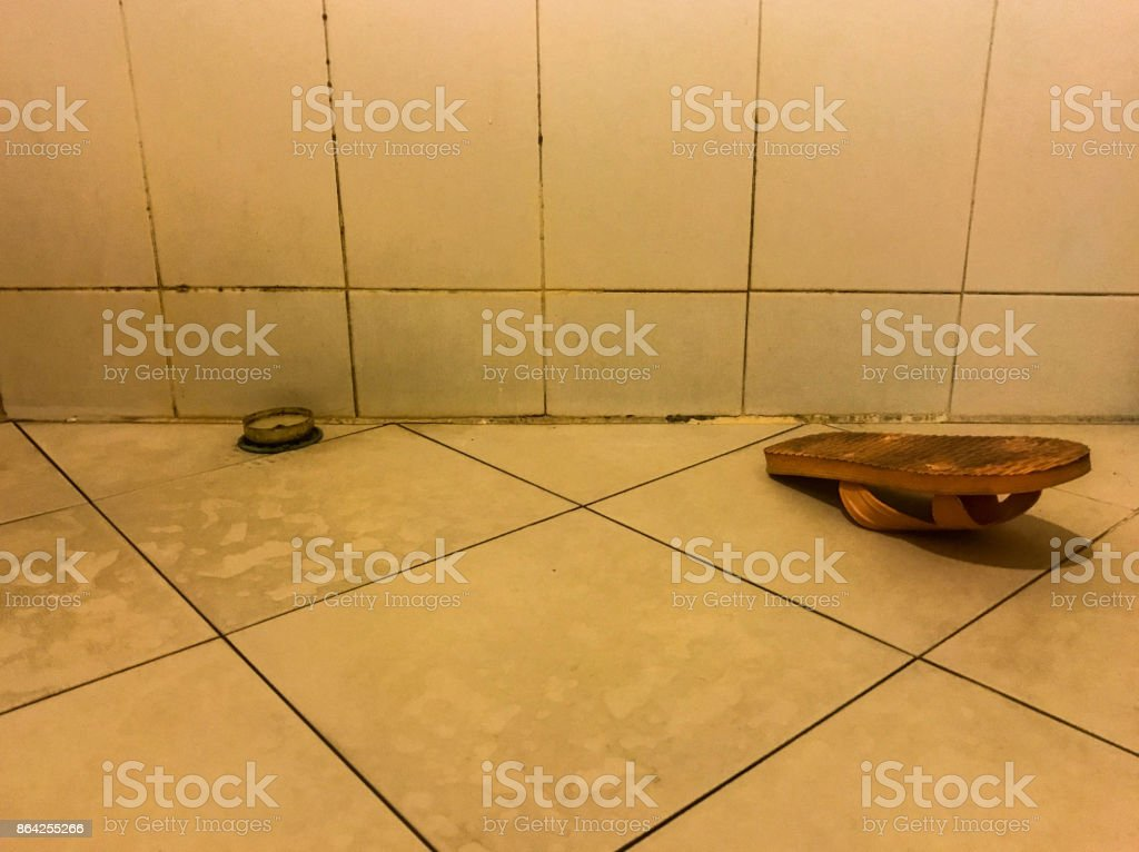 Dirty floor with slipper royalty-free stock photo