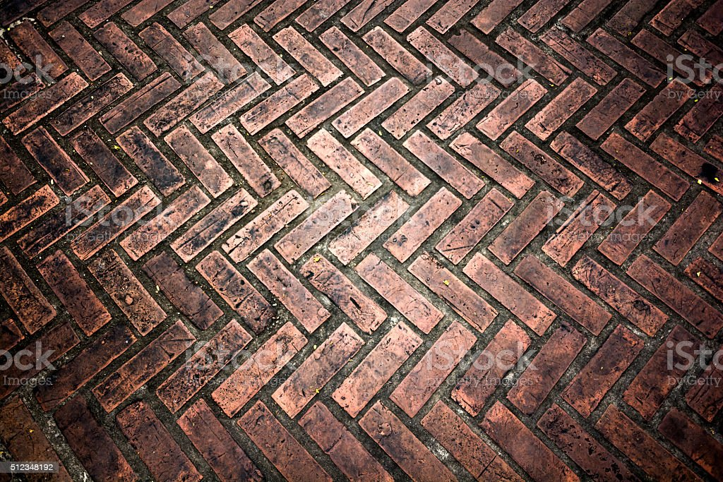 Dirty floor with ZigZag pattern of cement and brick stock photo