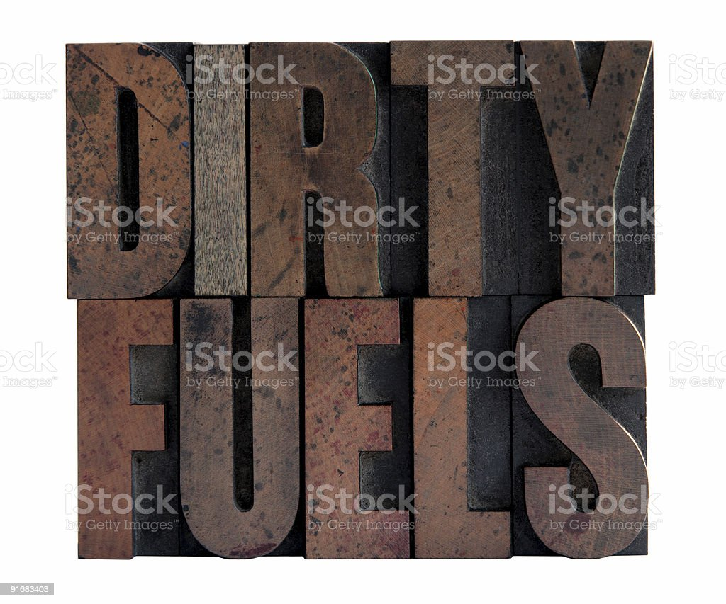 dirty fuels in letterpress wood type royalty-free stock photo