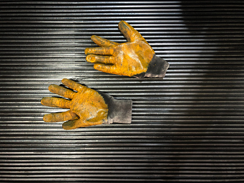 Dirty glove after work hard on workbench