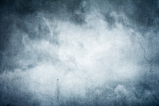 digital manipulation made out of 2 photos, concrete wall and stormy sky to achieve artistic effect
