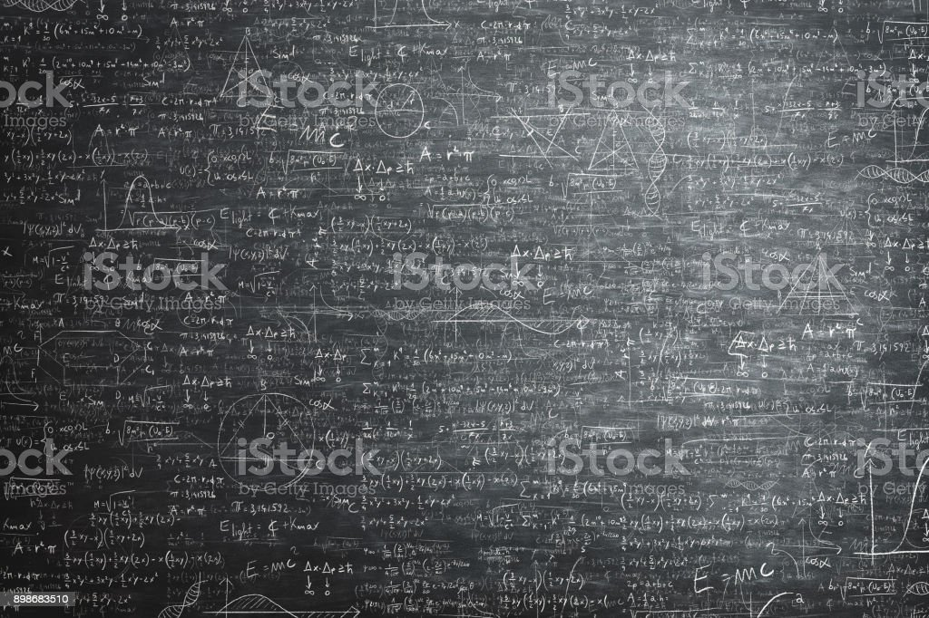 dirty grunge chalkboard full of mathematical problems and formula stock photo