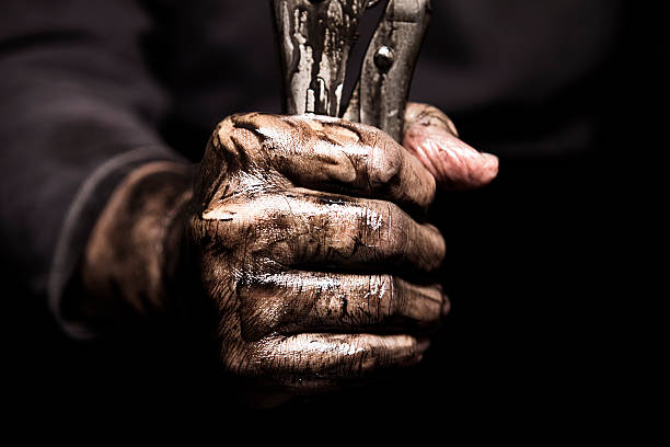 Dirty Hand Holding Wrench stock photo