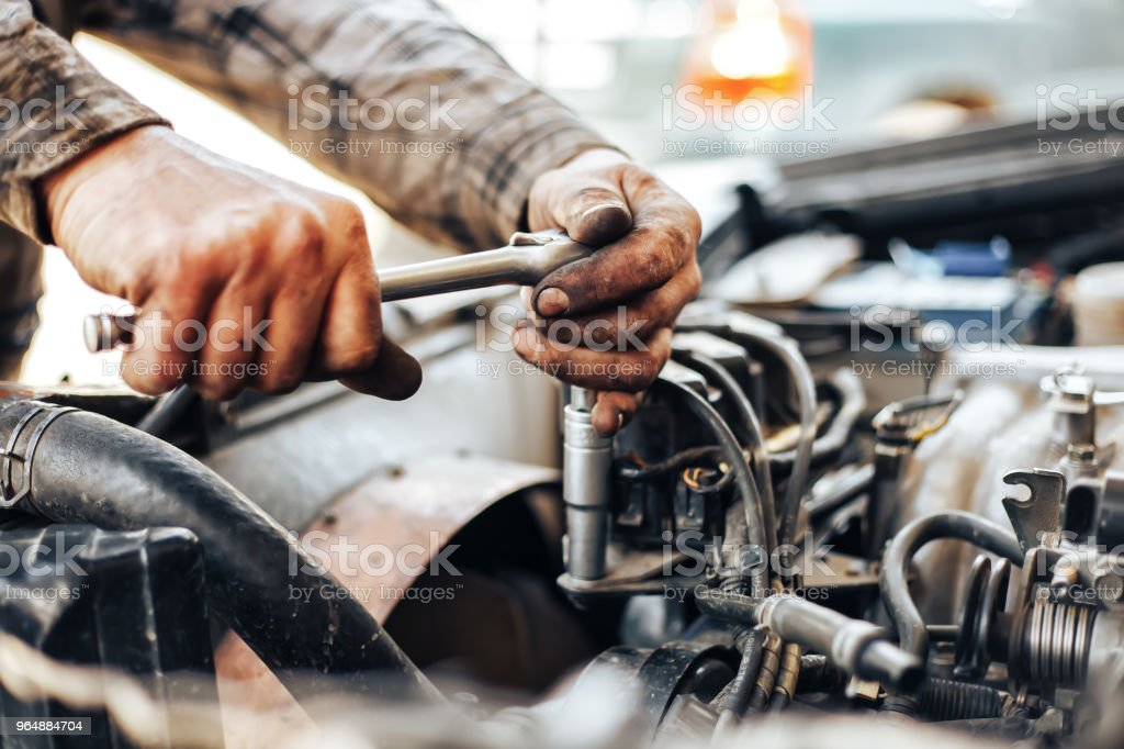 dirty hands of auto mechanic reparing car royalty-free stock photo