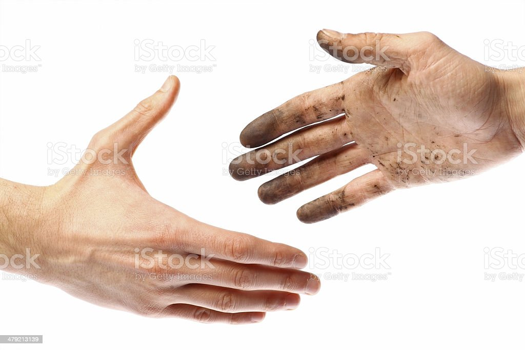 Dirty handshake stock photo