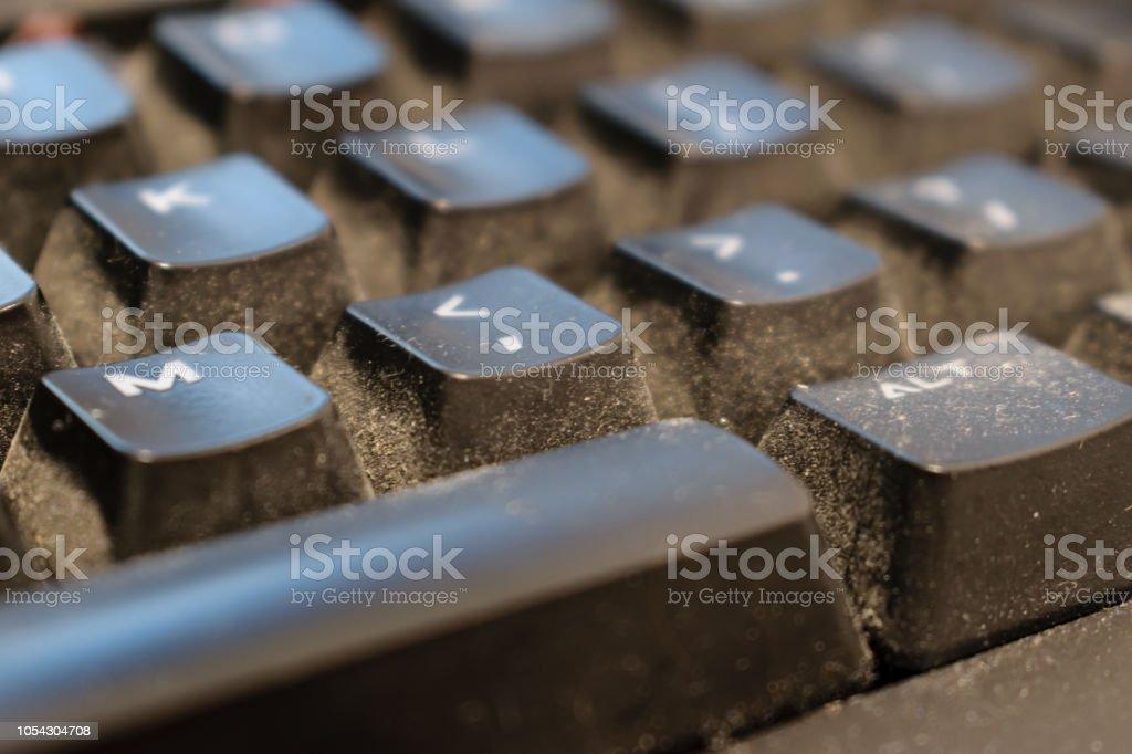 Dirty keyboard keys close up, health, hygiene hazard