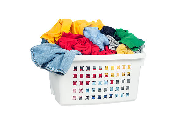 Dirty laundry A laundry basket full of dirty clothes ready to be washed during daily chores. laundry basket stock pictures, royalty-free photos & images
