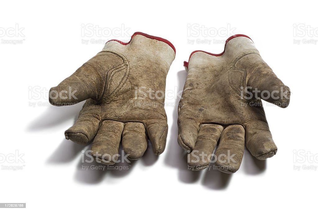 Dirty leather garden gloves stock photo