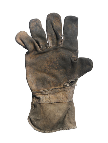 Dirty leather glove (with clipping path) isolated on white background