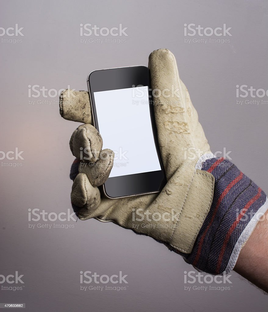 Dirty leather work glove with smartphone and clipping path stock photo