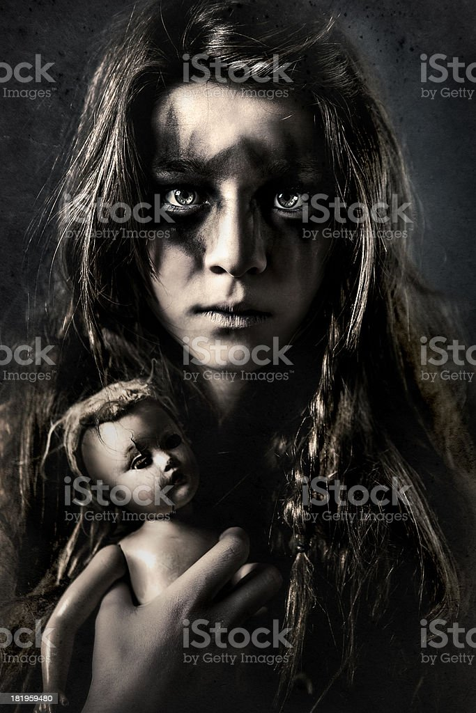 Dirty Little Girl Holding Creepy Doll royalty-free stock photo