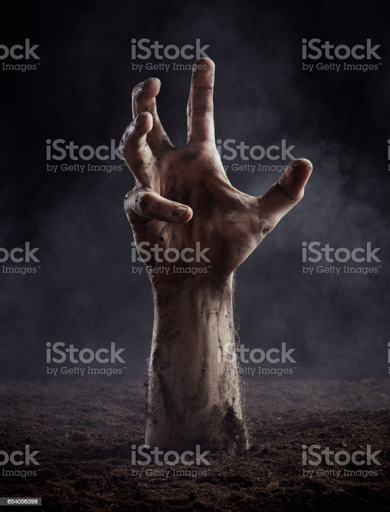 Dirty male hand on dark background stock photo