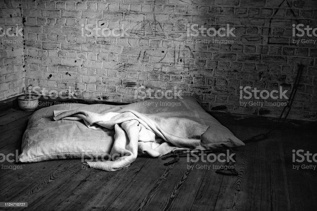 dirty mattresses and shackles stock photo