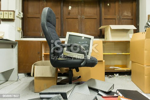 istock Dirty, messy and abandoned office, poor light 958887802