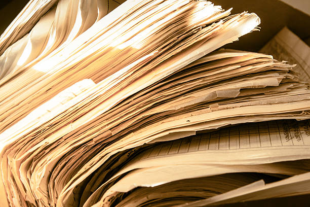 Dirty messy paper documents stock photo