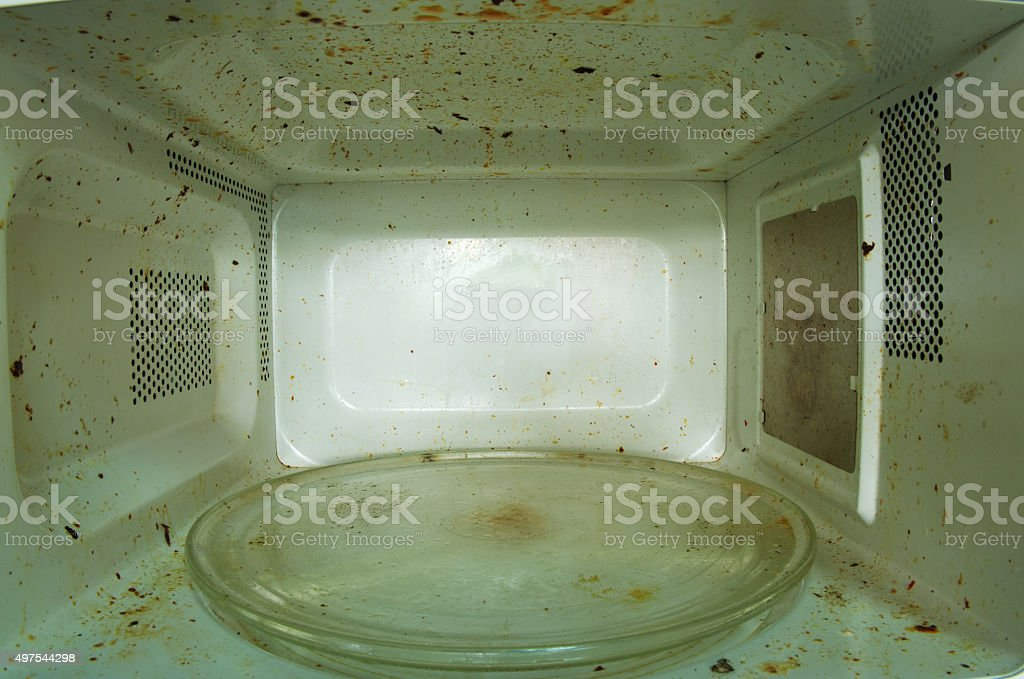 Dirty microwave oven stock photo