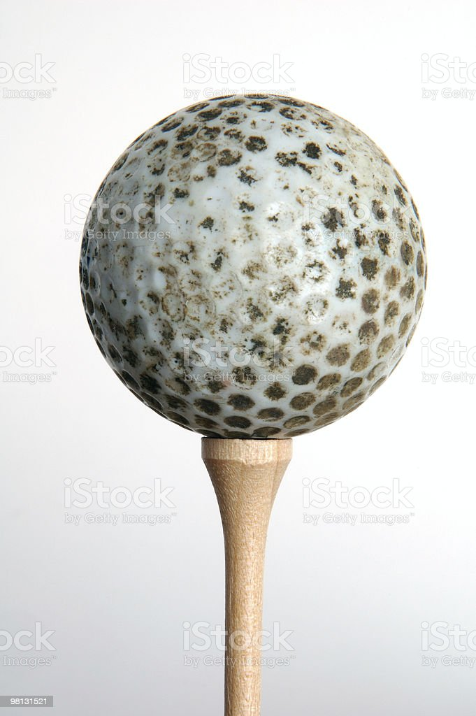Dirty old golf ball royalty-free stock photo