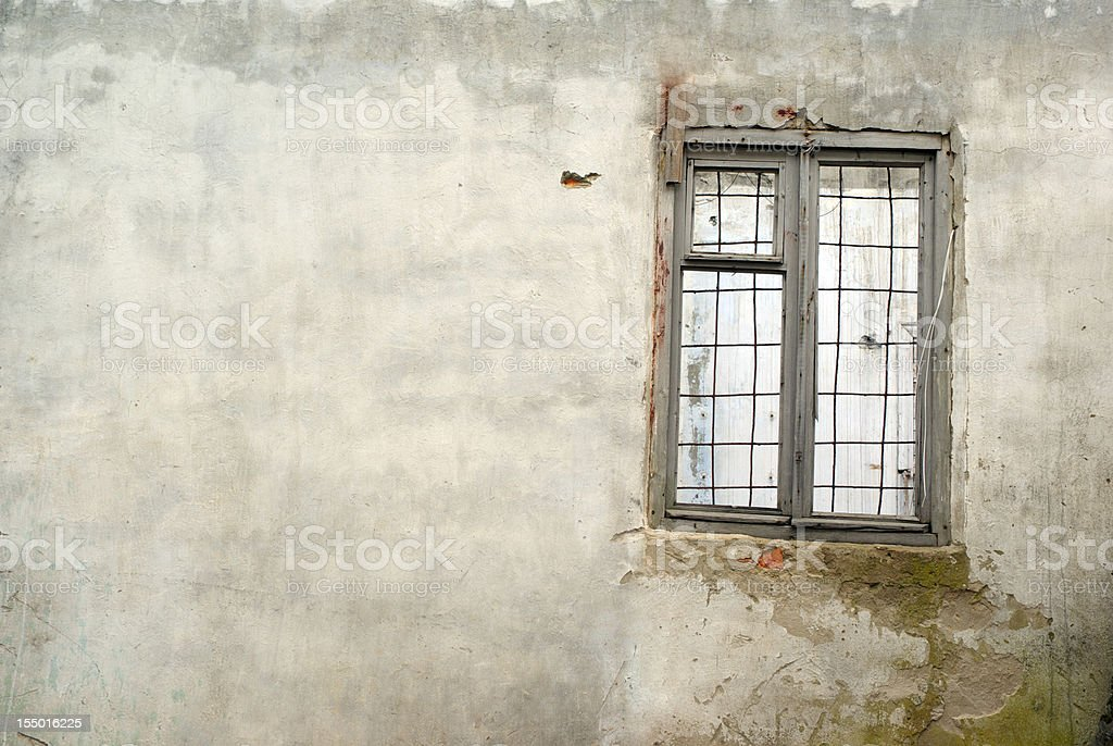 Dirty old wall and window bars royalty-free stock photo