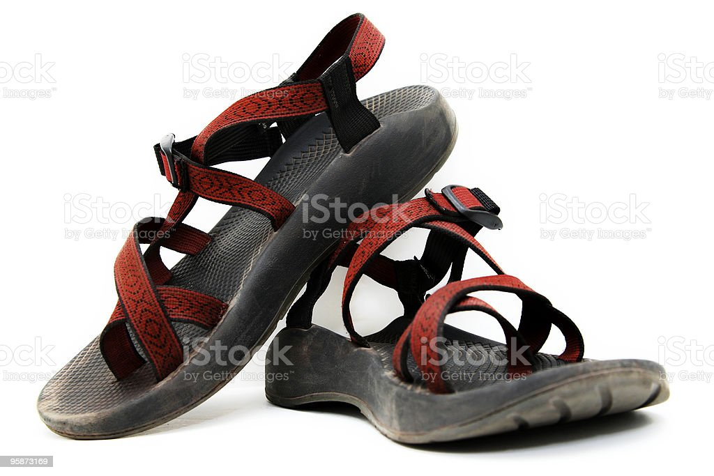 Dirty outdoor sandals on white royalty-free stock photo