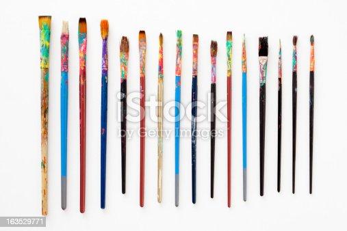 Several used paintbrushes isolated on white