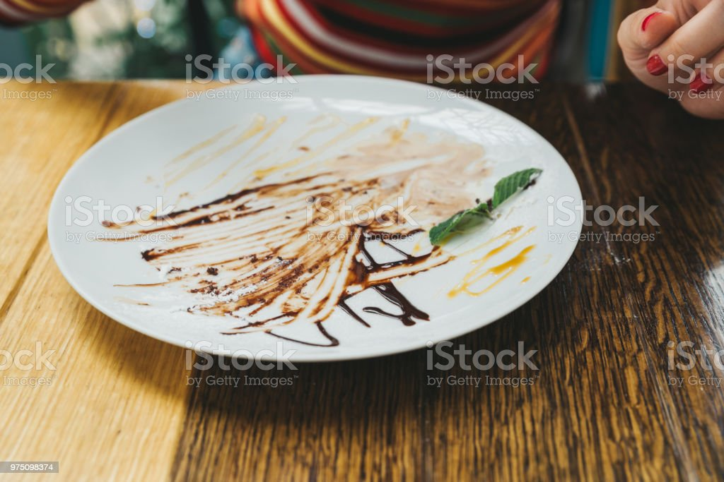 dirty plate. chocolate texture. delicious desert stock photo