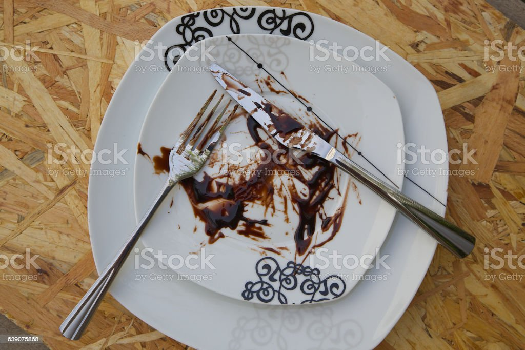 Dirty plate left after lunch dessert stock photo