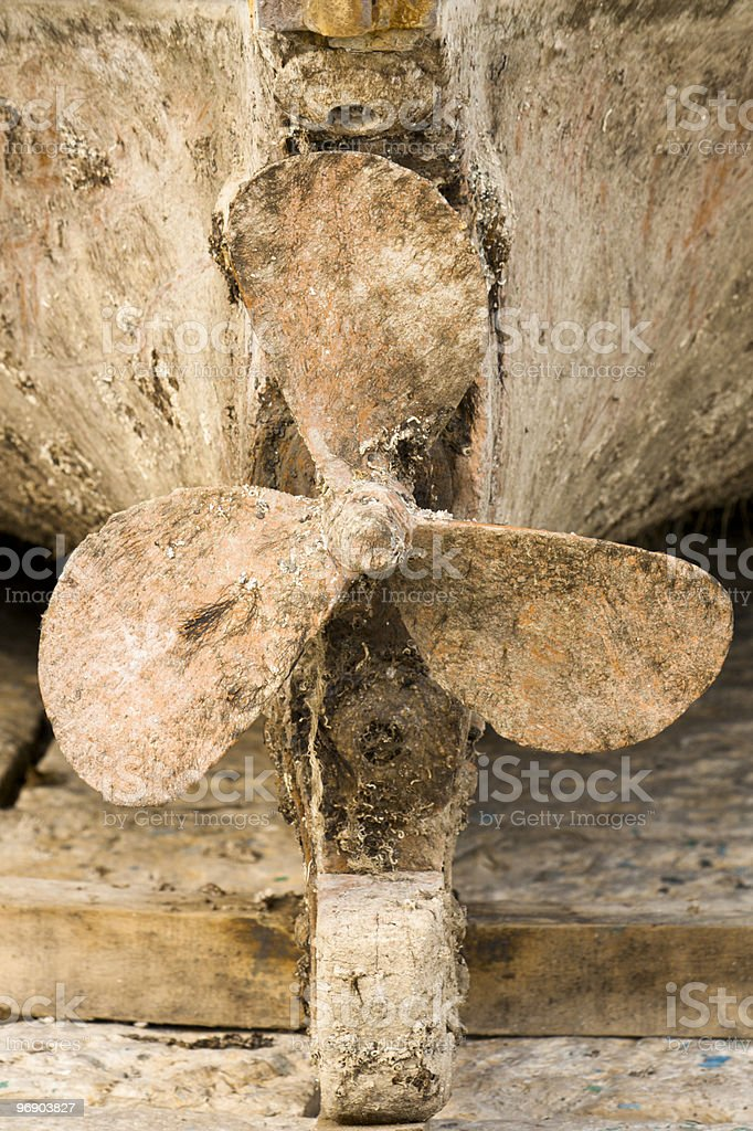 Dirty Propeller of an Old Boat royalty-free stock photo