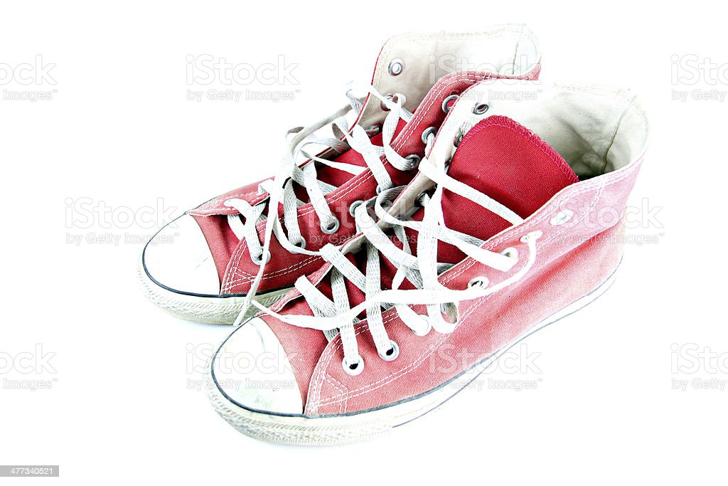 Dirty red sneaker isolated. royalty-free stock photo