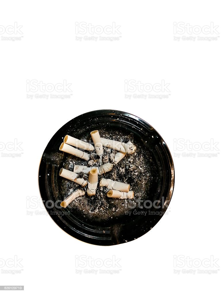 Dirty round dirty ashtray with cigarette butts and stubs extinguished stock photo