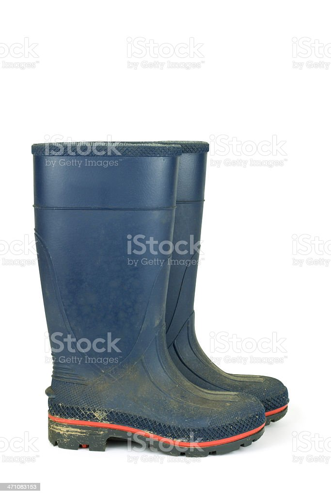 Dirty Rubber Work Boots stock photo
