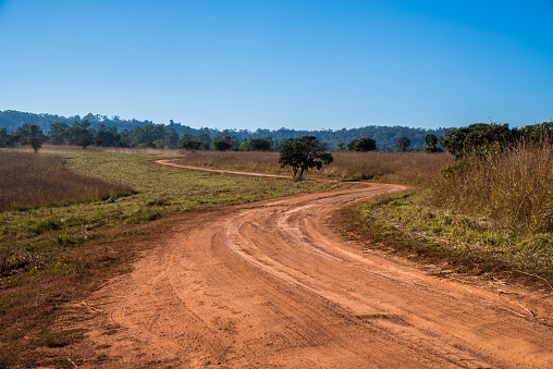 Dirty Rural road with dirt in countryside of Thailand