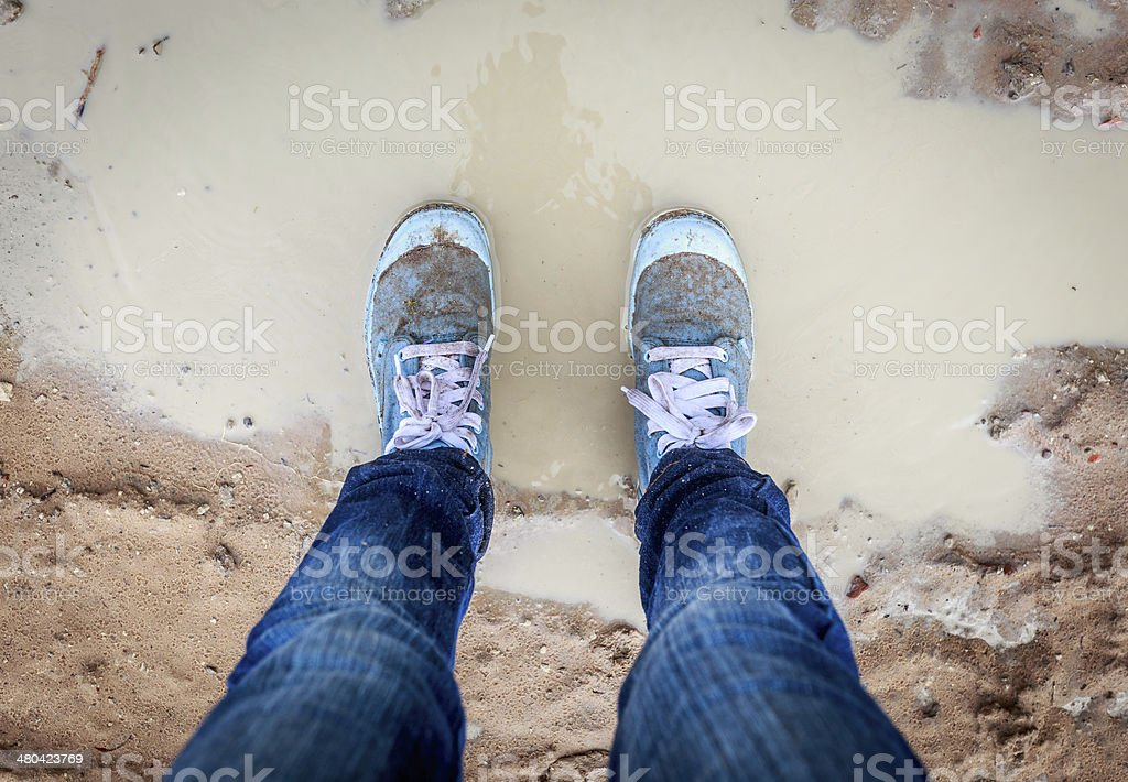 Dirty shoes on mud stock photo