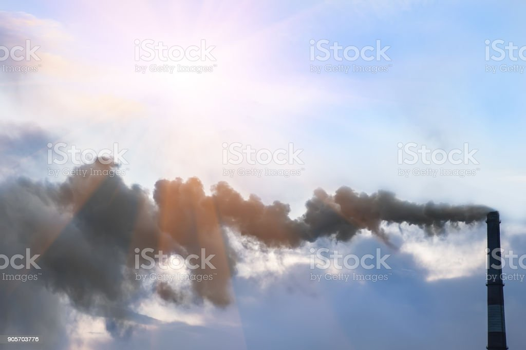 dirty smoke from an industrial pipe stock photo