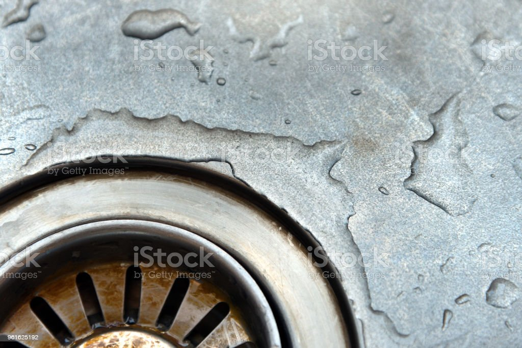 Dirty stainless steel sink drain. stock photo