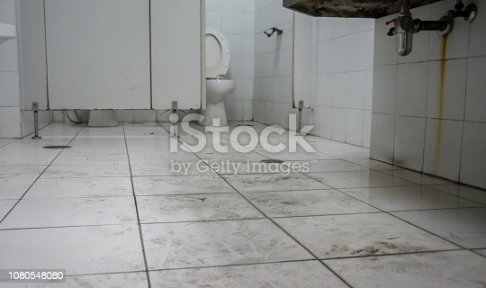 istock Dirty toilet in public building by human walk. 1080548080