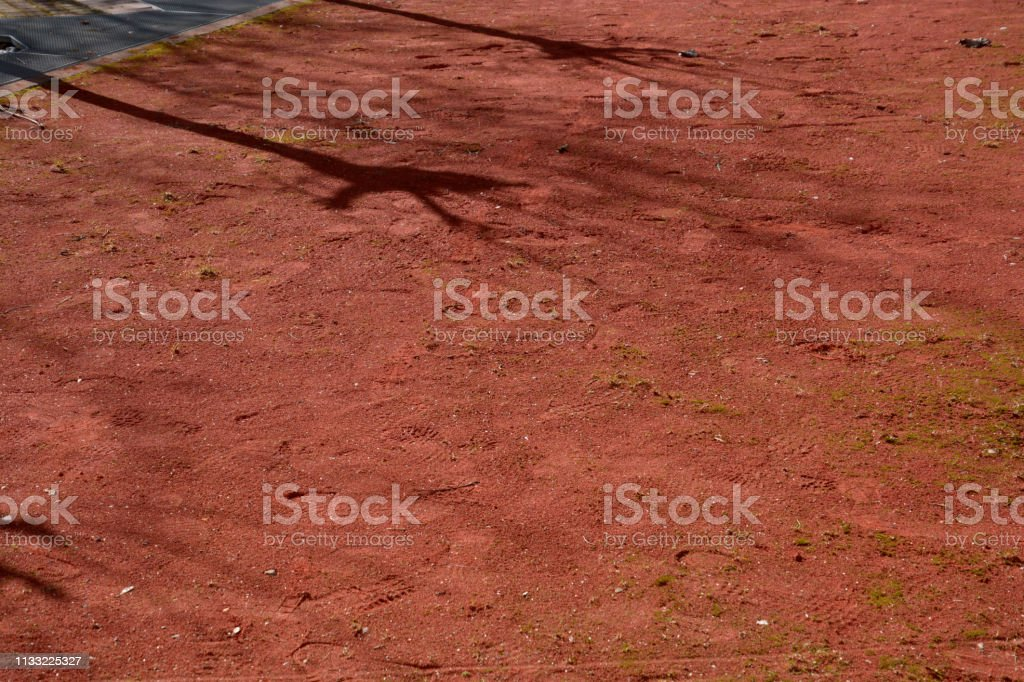 dirty traditional boules court made of red sand stock photo