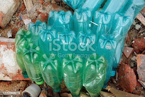 Dirty used plastic bottles pollution. Discarded plastic bottles in the trash.