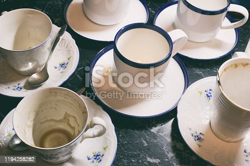 Bunch of dirty used white cups after drinking coffee or tea after party