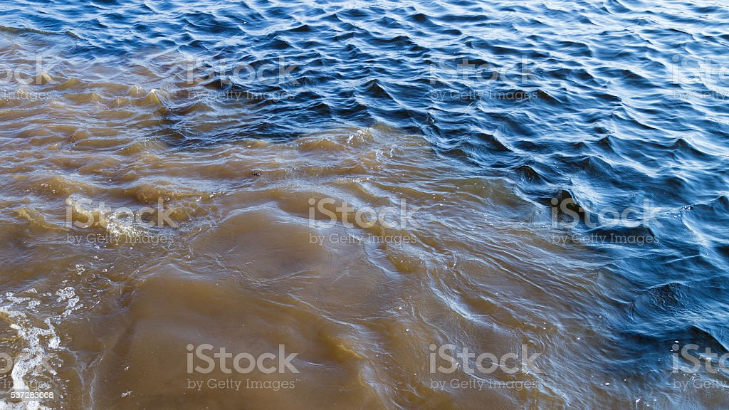 dirty water mixed with clean stock photo