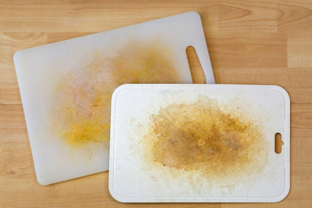 Dirty white plastic cutting board with dark stains, scratch stock photo
