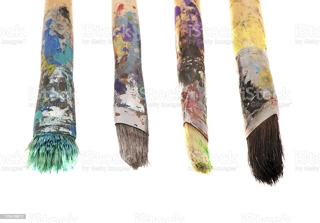 Dirty wooden paint brushes isolated on white royalty-free stock photo