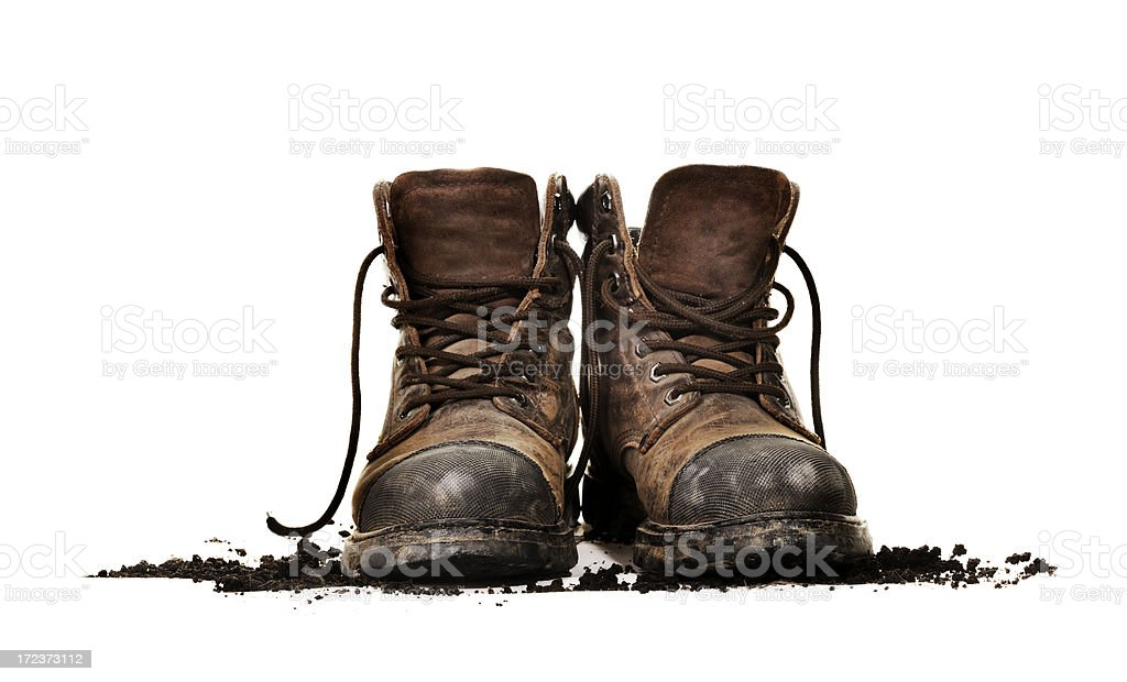 Dirty work boots isolated stock photo