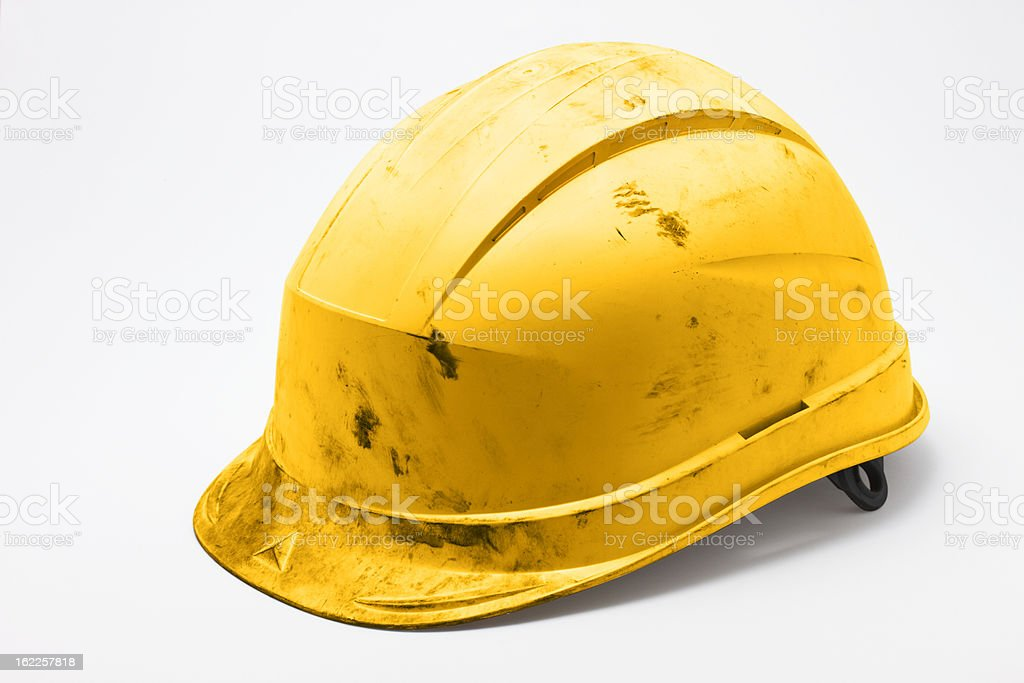 Dirty yellow hard hat stock photo