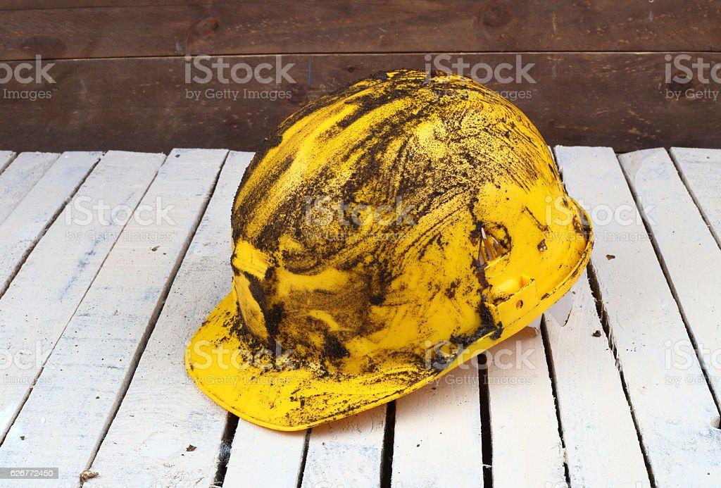 Dirty yellow helmet stock photo