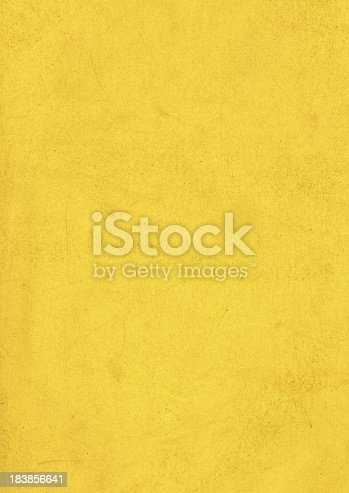 A grunge background of dirty old yellow paper